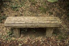 banc avec le bambou autour photo stock image 46996589. Black Bedroom Furniture Sets. Home Design Ideas