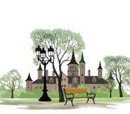 Banc en parc avec le vieux château derrière Images libres de droits