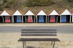 Banc et huttes Photographie stock libre de droits