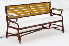 Banc et neige Photographie stock