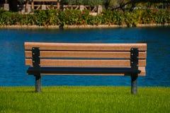 Banc par l'eau Photographie stock libre de droits