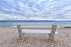 Banc sur la plage Photos libres de droits