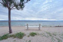 Banc sur la plage Photo libre de droits