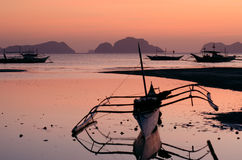 Banca on the bay in el nido palawan philippines. On beautiful lilac sunset sky Stock Photos