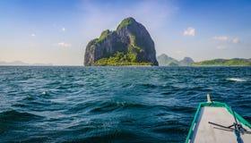 Banca Boat approaching Inabuyatan Island on Windy Day, El, Nido, Palawan, Philippines Stock Photo