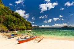 Banca boat at a beautiful tropical beach in Palawan Island,Phili. Traditional banca boats at the beach near Cudugnon Cave, El Nido, Palawan Island, Philippines Stock Photography