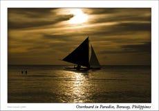 Banca Boat at Saling Sunset. Small Banca boat sailing at sunset near the beach Royalty Free Stock Image
