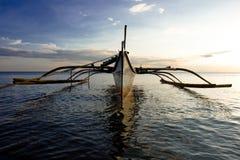 Banca Boat at Sun Set. Banca boat at sunset moored on the beach Stock Image