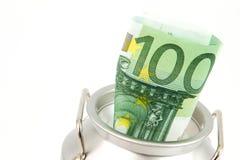 Banca di moneta con l'euro banconota Fotografie Stock
