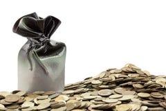 Banca di risparmio con le monete Fotografia Stock