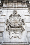 Banca dItalia. Frieze of the Bank of Italy from the facade of the building of the Milanene head office Stock Photo