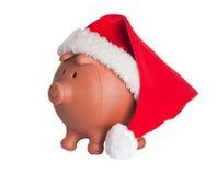Banca Piggy con il cappello del Babbo Natale Fotografia Stock Libera da Diritti