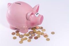 Banca Piggy con le euro monete Fotografia Stock