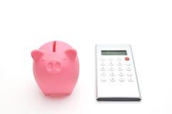 Banca Piggy e calcolatore Fotografie Stock Libere da Diritti