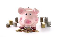 Banca Piggy e monete Fotografia Stock