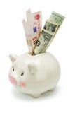 Banca Piggy e note importanti di valuta del mondo Fotografie Stock Libere da Diritti
