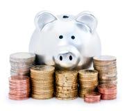 Banca Piggy ed euro monete Immagine Stock Libera da Diritti