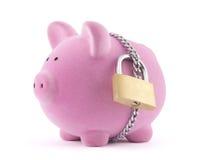 Banca Piggy fissata con il lucchetto Fotografia Stock