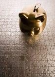 Banca Piggy sui puzzle Fotografia Stock Libera da Diritti