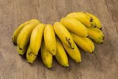 A banch of bananas and a sliced banana in a pot over a table. A banch of bananas and a sliced banana royalty free stock images