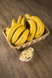 A banch of bananas and a sliced banana Stock Photos