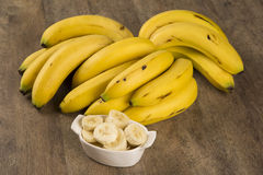 A banch of bananas and a sliced banana Stock Images
