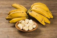 A banch of bananas and a sliced banana Stock Photography