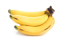 Banch delle banane su fondo bianco Fotografie Stock Libere da Diritti