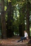 banch mężczyzna parka wschód słońca Fotografia Royalty Free