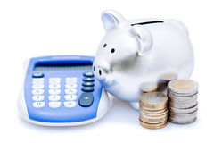 Banche Piggy con il calcolatore Fotografia Stock Libera da Diritti