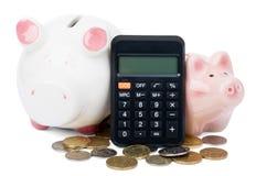 Banche Piggy con il calcolatore Fotografia Stock