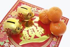 Banche Piggy e mandarini fotografia stock libera da diritti