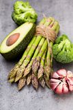 Bunch of fresh asparagus on wooden table. Royalty Free Stock Image