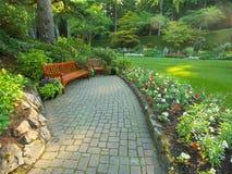 Banchi del giardino Fotografie Stock