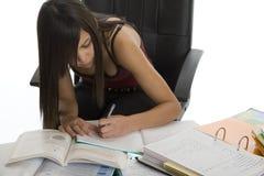 Banco, allievo femminile quando studiano Immagini Stock