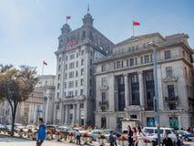 Banco cargado, noticias del norte AYA de China Daily y edificios de banco de Taiwán derecha a izquierda Foto de archivo libre de regalías