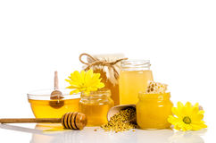 Banco de la miel con los panales, bol de vidrio con la miel Fotos de archivo libres de regalías