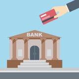 Banco de la tarjeta de crédito de la mano Imagenes de archivo