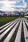 Banco de parque en otoño Imagen de archivo
