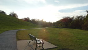 Banco de parque en otoño Fotografía de archivo