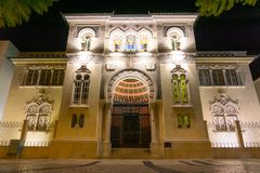 Banco de Portugal Faro moorish style building at night royalty free stock photo