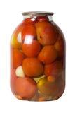 Banco de tomates adobados rojo conservados Imagen de archivo