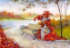 Banco decorativo en parque del otoño Foto de archivo