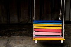 Banco del oscilación colorido en el hotel Imagen de archivo libre de regalías