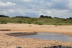 Banco di sabbia sull'estuario della spiaggia di Embleton Fotografie Stock