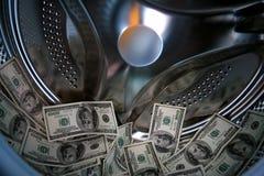 Banco dos dólares na máquina de lavar Fotos de Stock