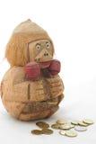 Banco e moedas de madeira do macaco Imagem de Stock