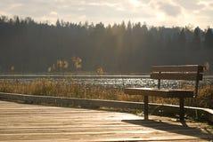 Banco en la calzada del lago Imágenes de archivo libres de regalías