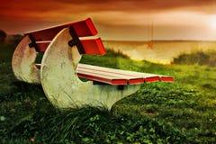 Banco en la playa herbosa HDR Fotografía de archivo libre de regalías
