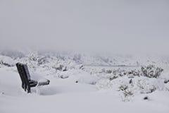 Banco en nieve Fotografía de archivo libre de regalías